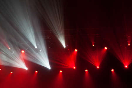 lighting equipment: Stage lights on concert. Lighting equipment with multicolored beams.