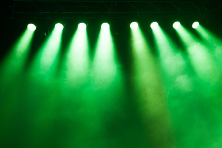 concert: Stage lights on concert. Lighting equipment with multicolored beams.