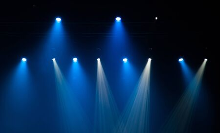 stage: Stage lights on concert. Lighting equipment with multicolored beams.