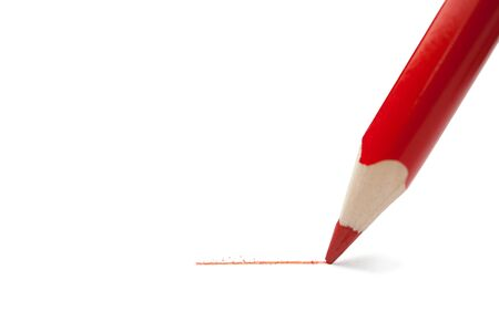withholding: Red pencil writes on paper.