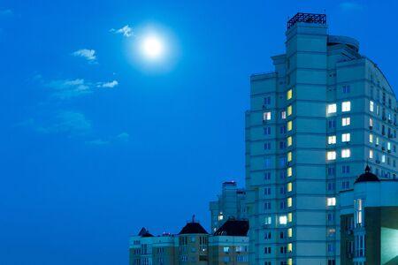 quarter: Moon in the night sky. Residential Quarter. Stock Photo