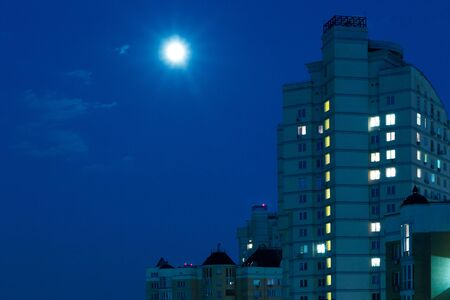 Moon in the night sky. Residential Quarter. Stock Photo