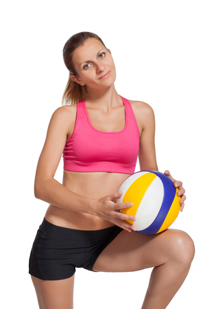 Beautiful athletic girl with a volleyball ball.