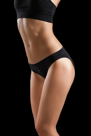 perfect female body: Slim body of woman isolated on black. Stock Photo
