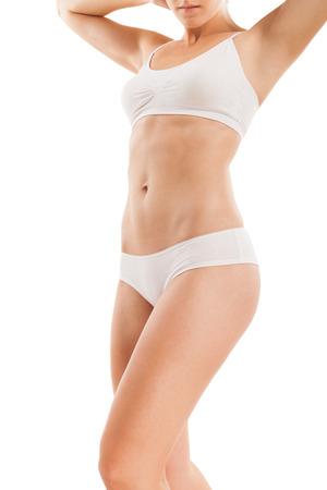 cuerpo perfecto femenino: Carrocería delgada de la mujer aislada en blanco.