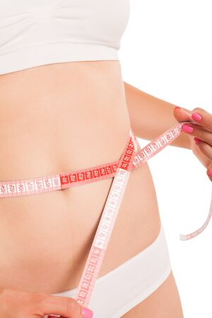 cuerpo femenino perfecto: Slim cuerpo de mujer con una cinta m�trica. Foto de archivo