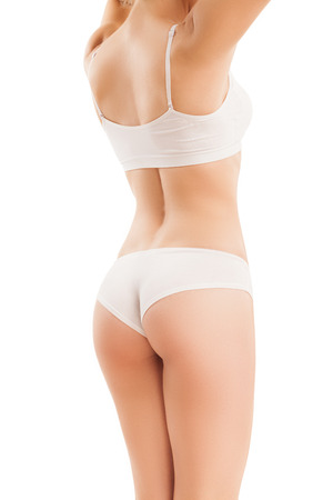 fit: Slim body of woman  isolated on white, from the back.