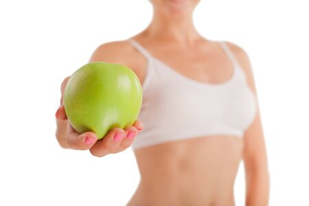 athletic girl: Athletic girl with green apple in hand.