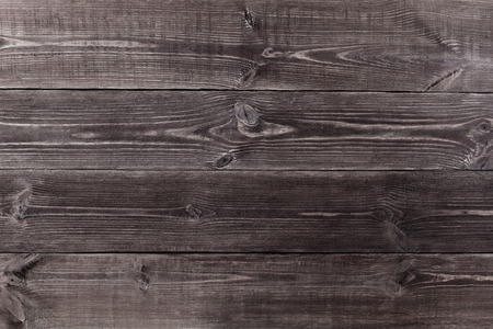 Background of wooden planks black color. Texture.