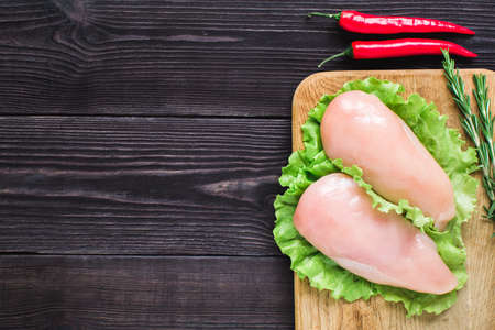 Chicken fillet on a cutting board. Top view. Stock Photo