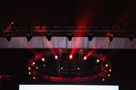 stage lighting: lighting equipment at concert stage. Colored beams.