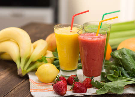 Fresh fruit smoothies on kitchen table in a two glass Stock Photo