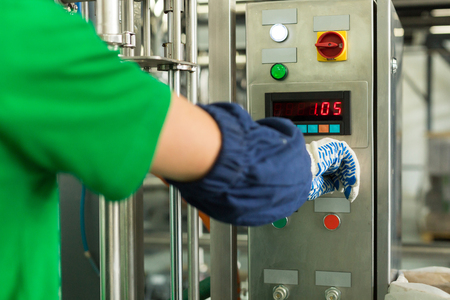 operative: Work includes a control panel in workshop. Concept: Manufacturing