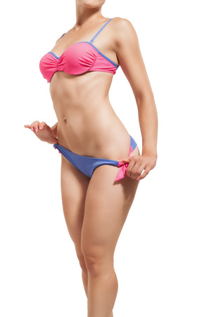 stature: Slender girl in a swimsuit isolated on white.