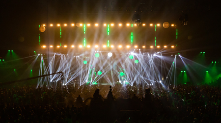 Stage illuminated by beautiful rays of lighting equipment.