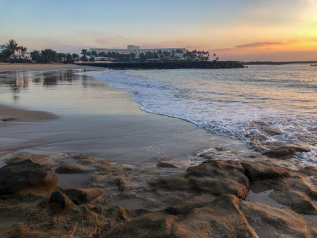 Morning ebb on the beach in Costa Teguise. Island Lanzarote, Spain.
