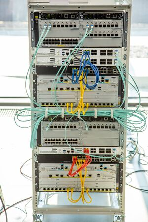 Ethernet, wired transmission. Network security equipment. Cybersecurity infrastructure. Switch or router socket, cable connections.
