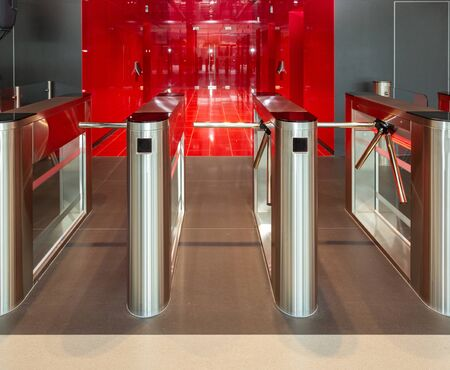Security office center. Turnstile with card reader. Electronic checkpoint with a turnstile in the office center. Turnstile spinner.