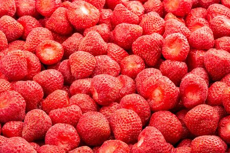 Frozen fresh strawberry. Food background of berries. Frame filled with strawberry. Top view.