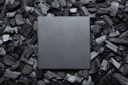 Empty stone plate on charcoal. The square frame is black. Copy space. Place for text.