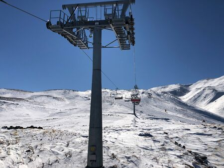 Ski lift in the ski resort of Erciyes, Turkey. Beautiful relief, bright sun, snowy slopes.