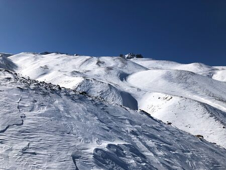 Ski resort of Erciyes in Turkey. Beautiful relief, bright sun, snowy slopes.