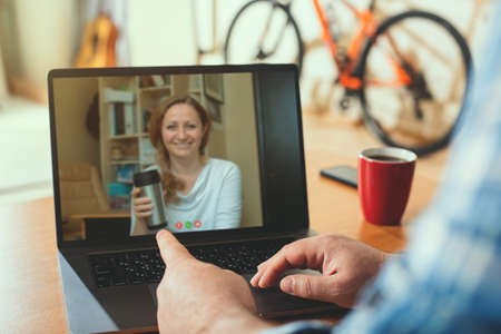 Video call. Working from home using a webcam to communicate with colleagues. Imagens