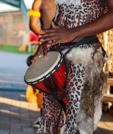 An African drummer plays the djembe.