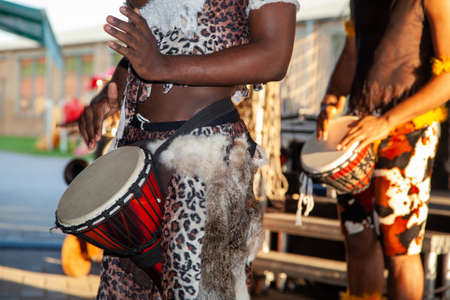 An African drummer plays the djembe. Traditional musical instrument.