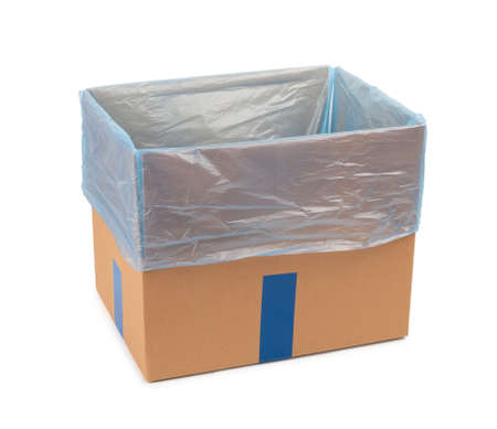 Opened cardboard box for storing goods and parcels by mail with a plastic bag inside. Isolated on white background.