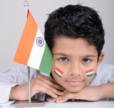 indian boy: Cute looking indian kid with indian flag