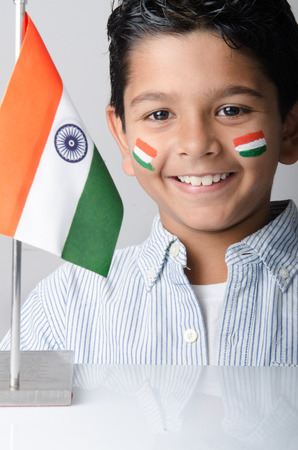 Cute looking indian kid with indian flag photo