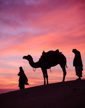 madina: Rajasthan desert with dramatic sky with camel and man Stock Photo