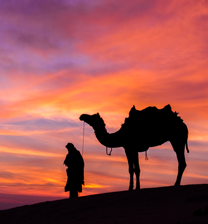 ramzan: Rajasthan desert with dramatic sky with camel and man Stock Photo