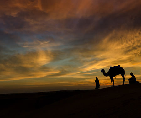 thar: Rajasthan desert with dramatic sky with camel and man Stock Photo