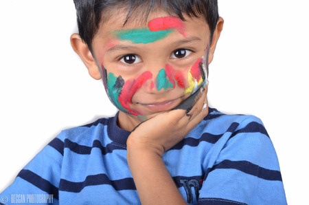 child finger: Cute kid playing with paints