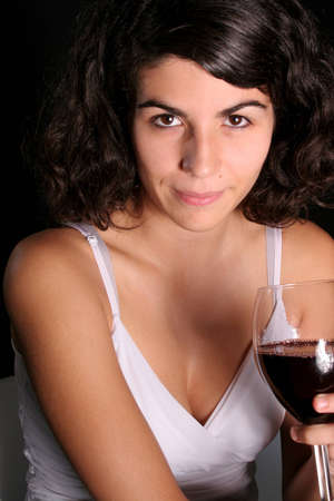 portrait of a woman with a glass of wine with black background photo