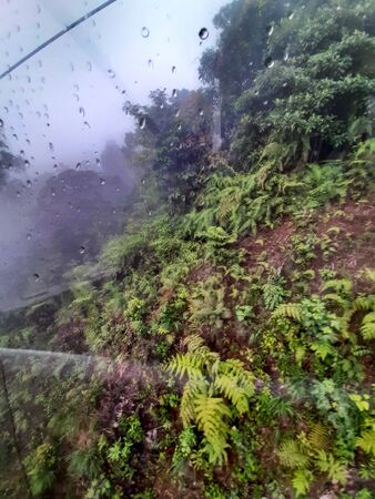 View of cable car to Genting highland with the water dropped on the glass in Kuala Lumpur Malaysia