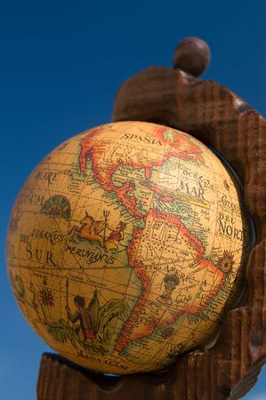 Globe map showing America against blue sky photo