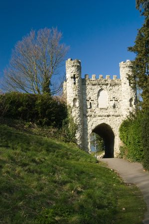 Reigate castle ruins with leading path and green grass against blue sky Stock Photo
