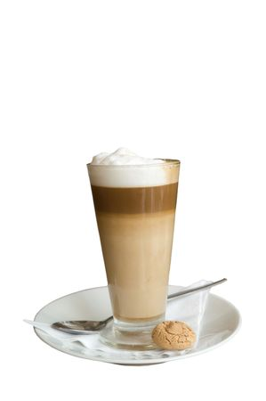 Cafe Latte in a clear glass with an almond cookie, agains dark brown wood background