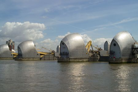 famous industries: Thames Barrier on a sunny day with blue sky and fluffy white clouds