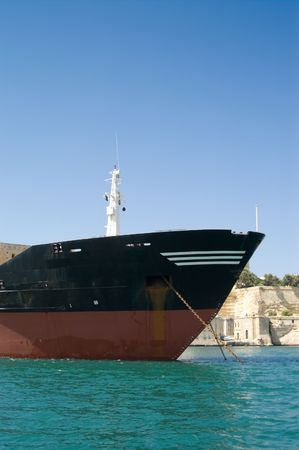 Detail of large merchant ship on turquoise water Stock Photo