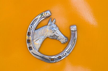 Detail of metallic horse shoe with horse head Stock Photo