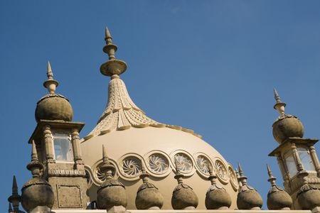 Close up detail of Royal Pavilion dome in Brighton,  against blue sky