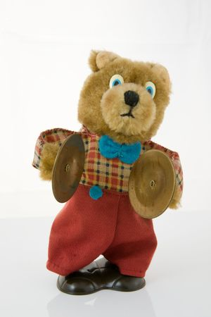 Wind-up teddy bear with brass cymbals, isolated against a white background Stock Photo