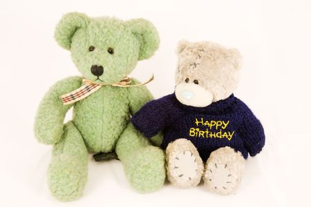 Couple of old fashioned teddy bears, isolated against white background