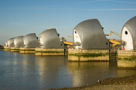 Thames Barrier at sunset against a clear blue sky Stock Photo