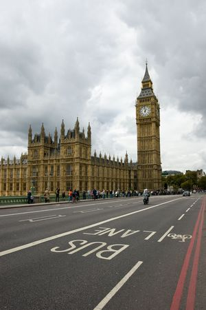Houses of Parliament and Big Ben with detail of bus lane and moody sky