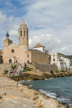 View of church and palace from pier, Sitges, Spain